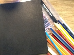 notebook and colored pencils