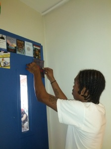 A proud student adding Quiet by Susan Cain to the other side of the door.