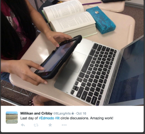 Student finishing up an online literature circle discussion using Edmodo.